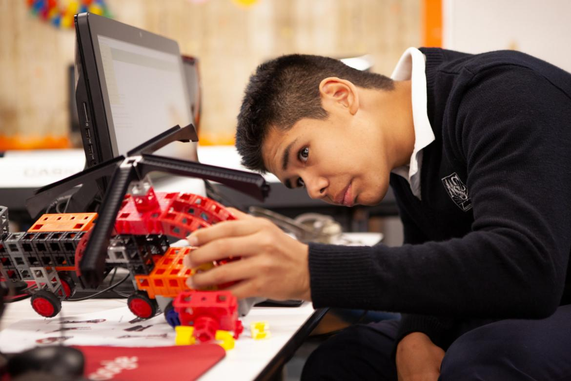 Image of a student building a robotic helicopter from a STEM kit