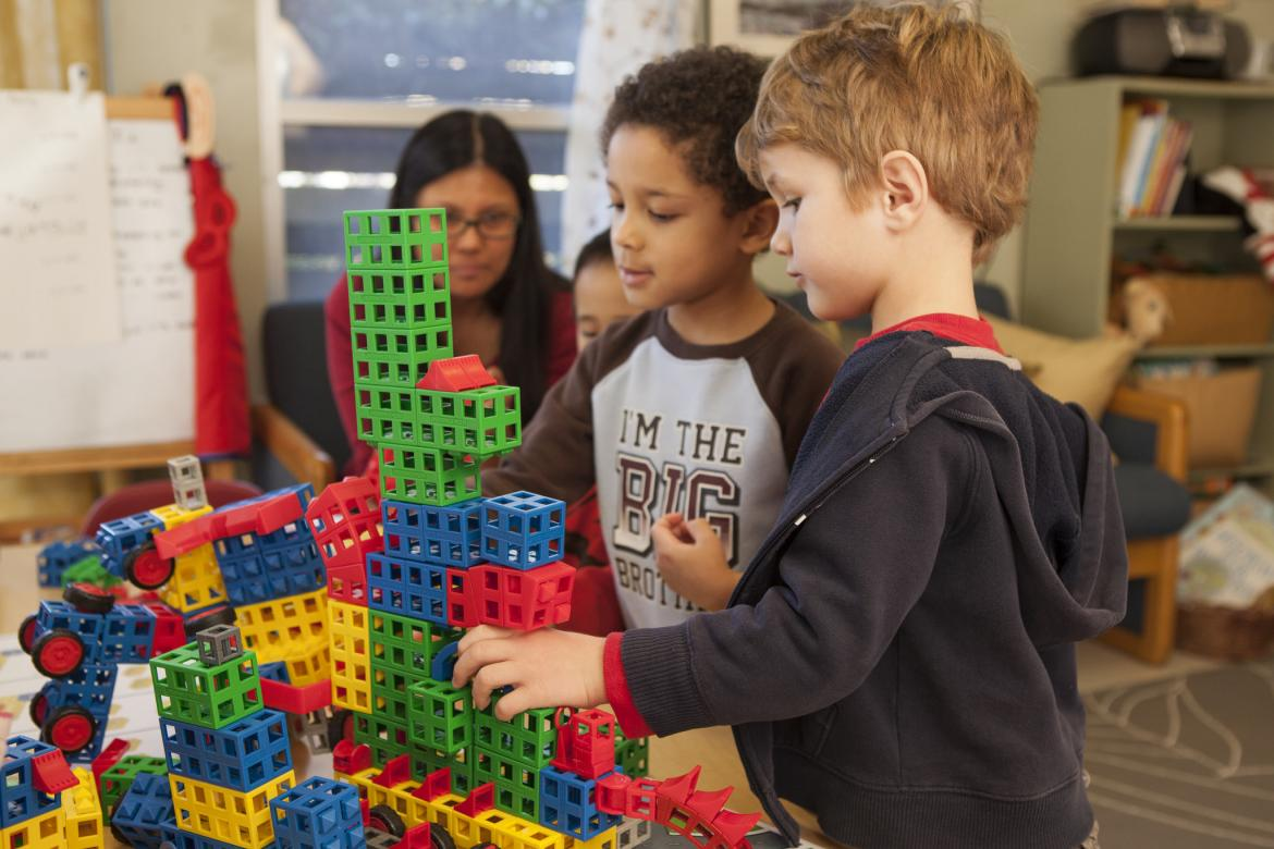 Two Students Building with ROK Blocks