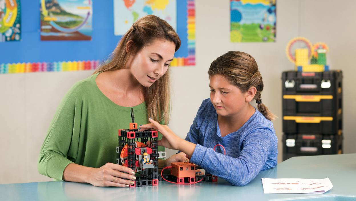 Image of a student working with her STEM mentor with a STEM kit