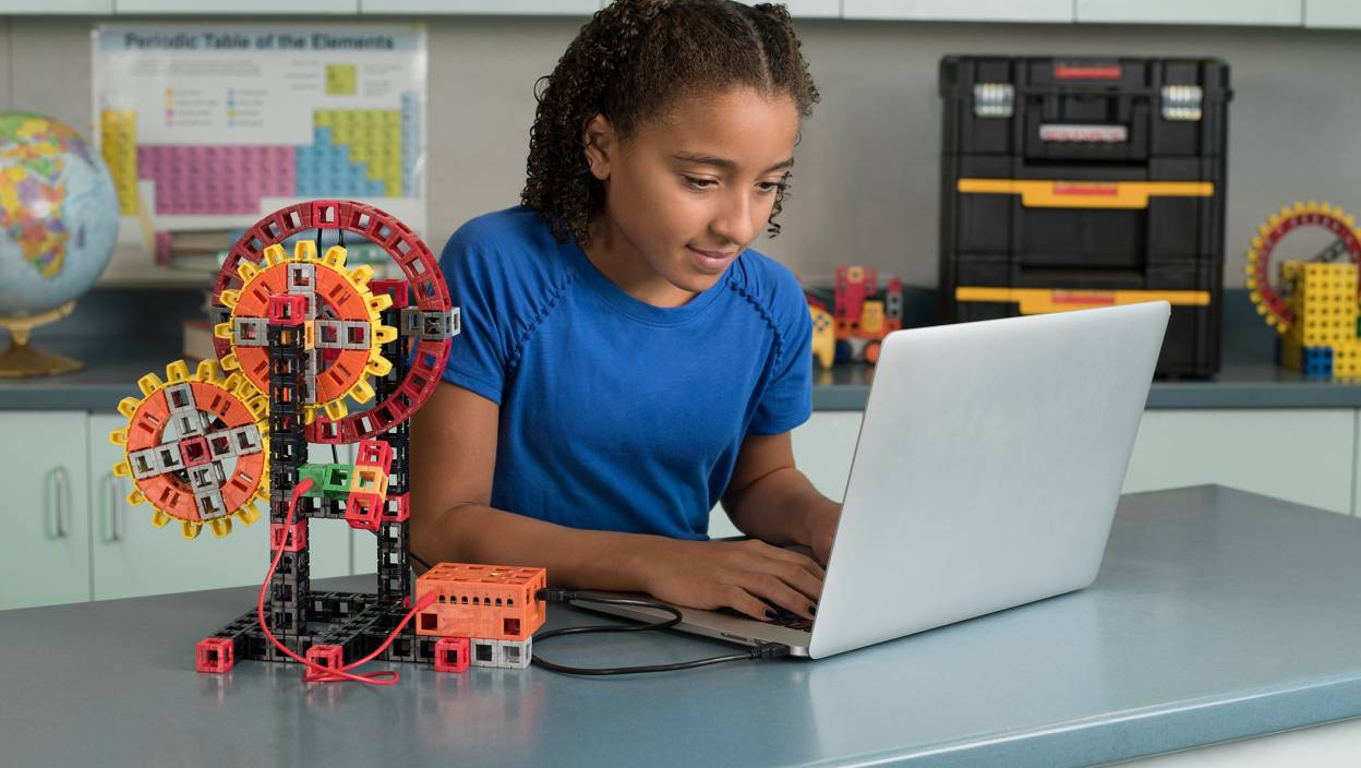 Image of middle schooler working with a mechanical STEM kit from Kid Spark