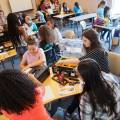 Image of students using STEM kits at a table